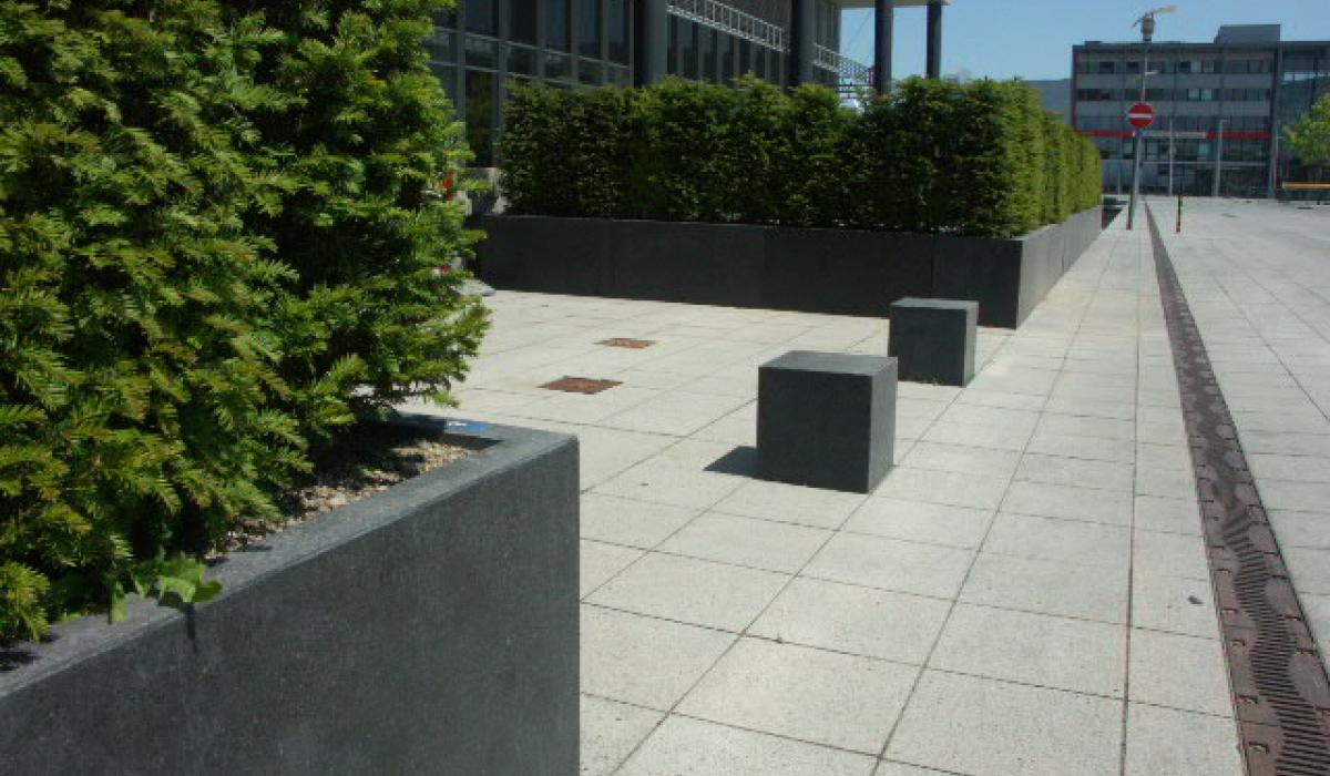 Planters and bollard in front of MMC studios
