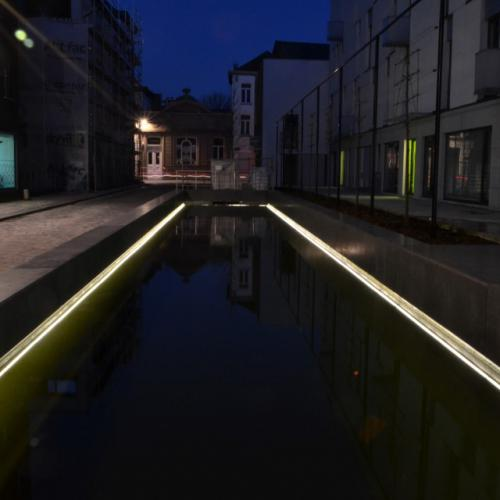 Street with water and LED in concrete in Bruul area, Mechelen
